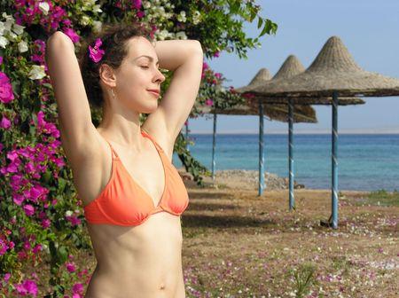 girl on beach with flowers photo