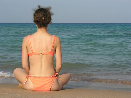 behind girl on beach photo