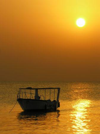 profound: boat at sunrise Stock Photo