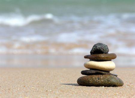 dozens: pyramid of stones. beach Stock Photo