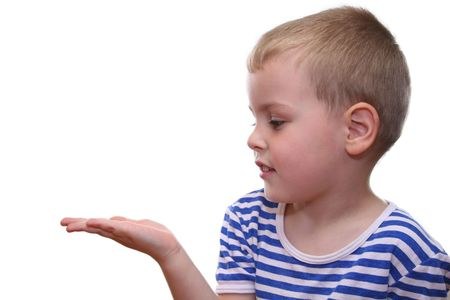 handbreadth: put something on boys hand Stock Photo