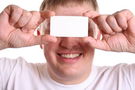man with card for text on eyes photo