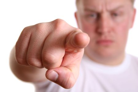 gruff: angry boy with finger to you Stock Photo