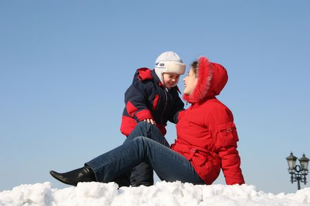 mother sit with son. winter photo