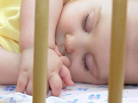 baby sleep in bed photo
