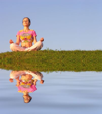 girl meditation blue sky and water photo