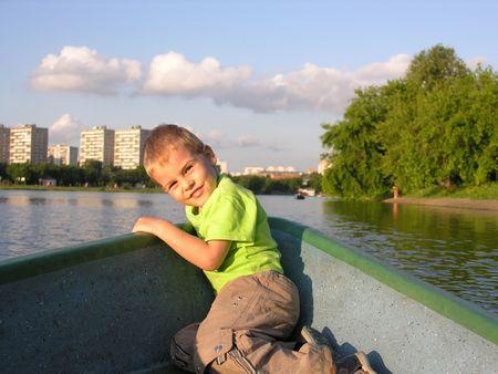 child on boat photo