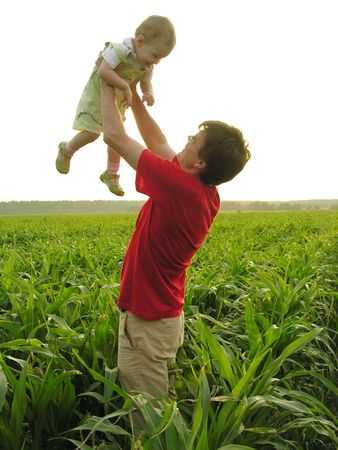 shadowgraph: father with baby in field