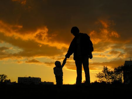 shadowgraph: father with  sunset Stock Photo