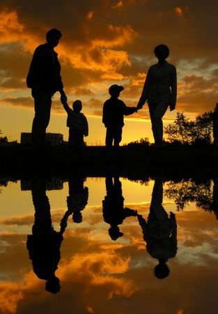 children pond: family of four sunset 2 and water