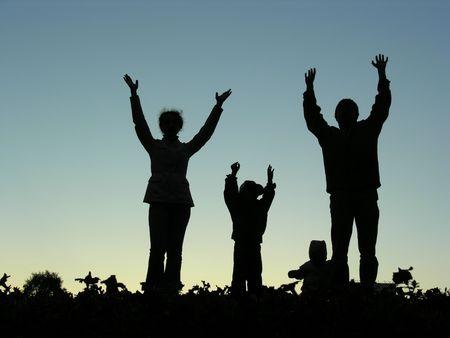 family hands up sundown photo