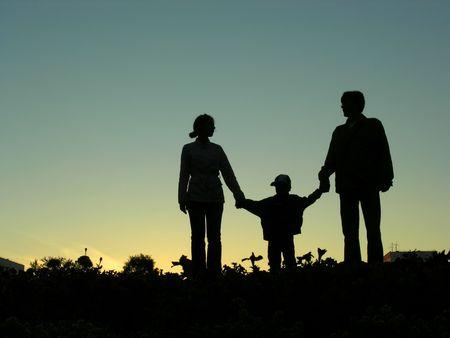 family with boy sundown 2 Stock Photo - 547828