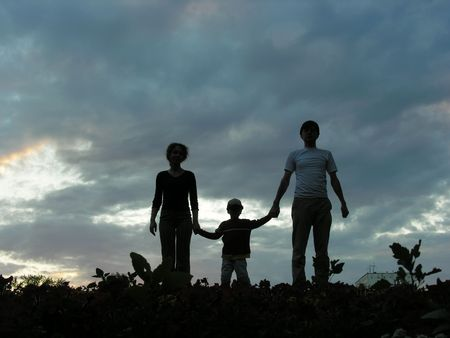 family on evening sky Stock Photo - 547814