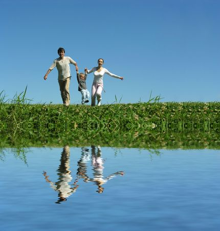 joga: family on herb under blue sky and water