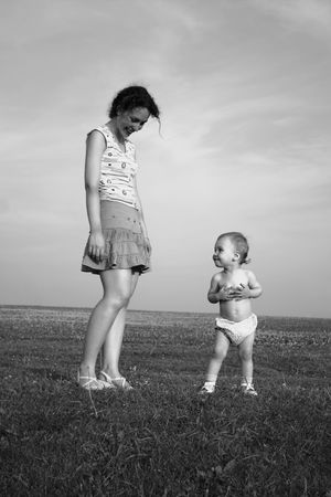 mother with baby on meadow Stock Photo - 547696