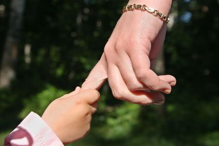mother's  and baby's hands in park Stock Photo - 547678