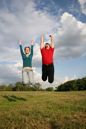 full strenght: jump couple on meadow