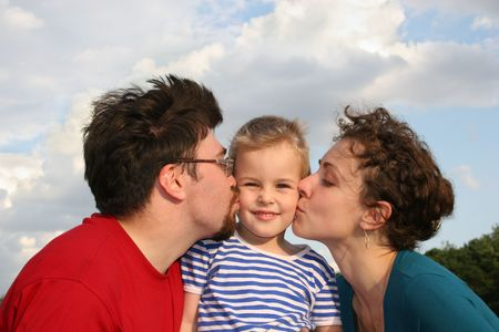 parents kiss son Stock Photo - 547607