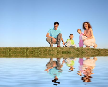 family of four on meadow and water photo
