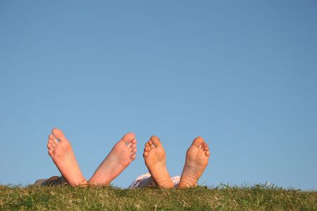 sinkers: couple legs on grass Stock Photo