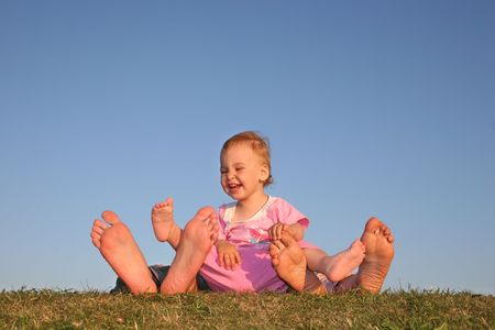 sinkers: baby and parents legs Stock Photo