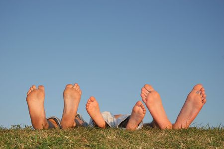 sinkers: family legs on grass Stock Photo