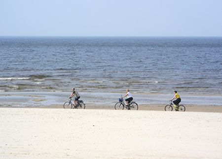 baltic people: bicycling by the sea Stock Photo