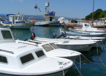 motorboats: Liitle harbor with yachts and motorboats at Brela, Croatia                  Stock Photo