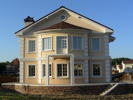 erected: Newly erected building in village at suburb of city