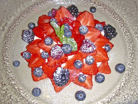 caster: dessert of fresh berries with caster sugar at restaurant