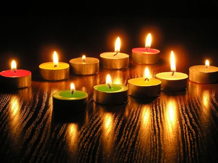 On a photo of a candle as different figures. A photo on a dark background. The photo is made in Ukraine. photo