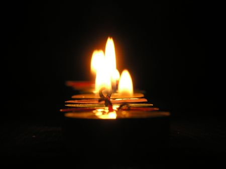 On a photo of a candle as a line. A photo on a dark background. The photo is made in Ukraine.