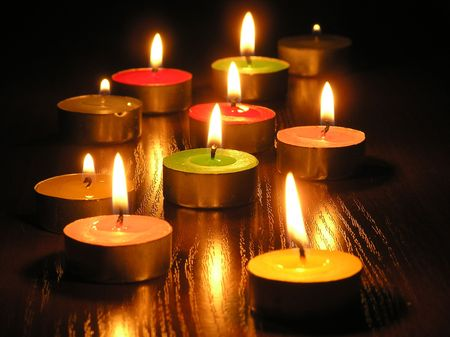 On a photo of a candle. A photo on a dark background. The photo is made in Ukraine. Stock Photo