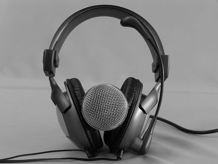 Black-and-white photo. On a photo a microphone and headphones. The photo is made in Ukraine.       photo