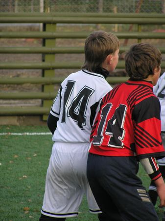 On a photo two players in football from different teams. Two 14 numbers in struggle for an advantage-ground at reception of a ball. The photo is made in Ukraine during children's tournament on pass to football Stock Photo - 906911