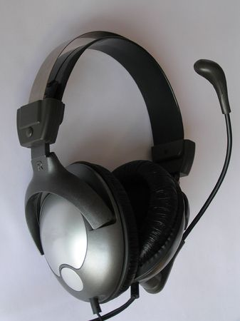 On a photo headphones close up are represented. They on a white background. The photo is made in Ukraine    photo