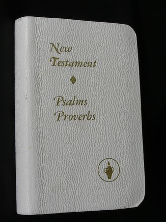 writ: On a photo on a black background the New testament. The photo is made in Ukraine.     Stock Photo