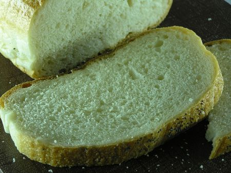 bake sale: On a photo a slice of bread. Bread white, fresh. The photo is made in Ukraine