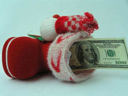 On a photo a boot for gifts with 100 dollar denomination. A boot red. The photo is made in Ukraine photo
