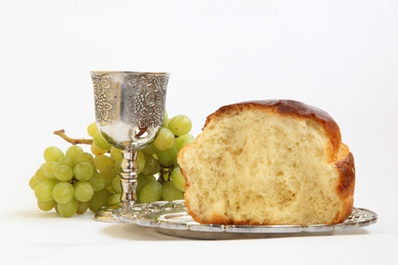 Holy Communion. The bread and wine grapes