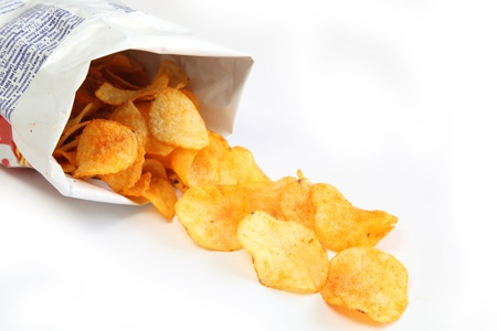 Potato chips in a package isolated on white background photo