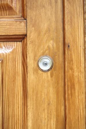 peephole: peep-hole in the wooden doo