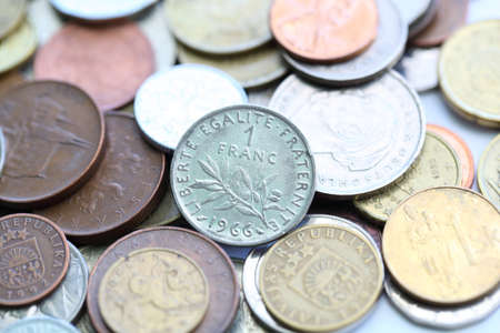 reversing: 1 franc coin in the middle of old coins