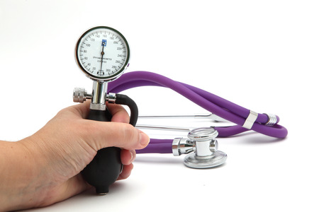 measurement of pressure and stethoscope isolated on white background photo