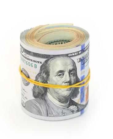 Pack of dollar bills on white background photo