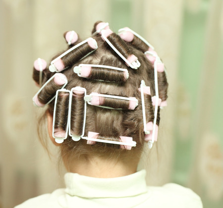 little girl in hair curlers photo