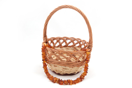 Necklace from amber in wooden basket photo