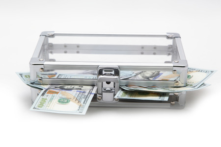 Case with money on a light background photo
