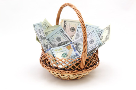 christmas debt: basket of dollars on a white background