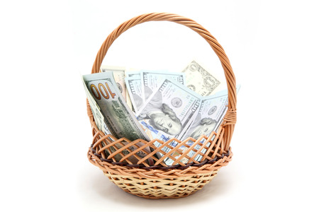 basket of dollars on a white background photo